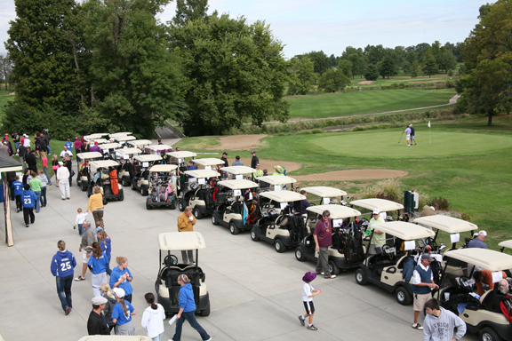 People scurry about during a golf outing